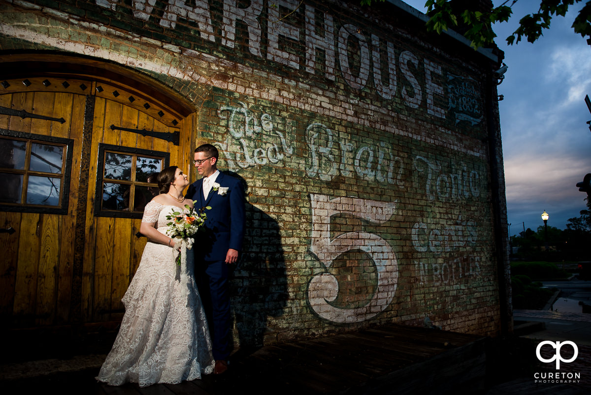 Bride and groom at sunset on the back deck of Old Cigar Warehouse.