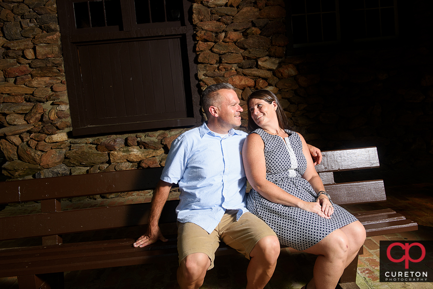 Couple sitting on the bench at Paris Mountain State Park.