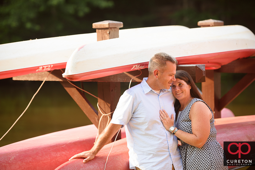 Couple on a boat during an engagement session at Paris Mountain State Park in Greenville,SC..