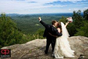 Bride and groom on a cliff after their wedding at Pretty Place.