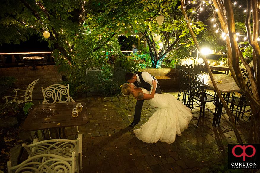 Newlywed couple dancing in the rain.