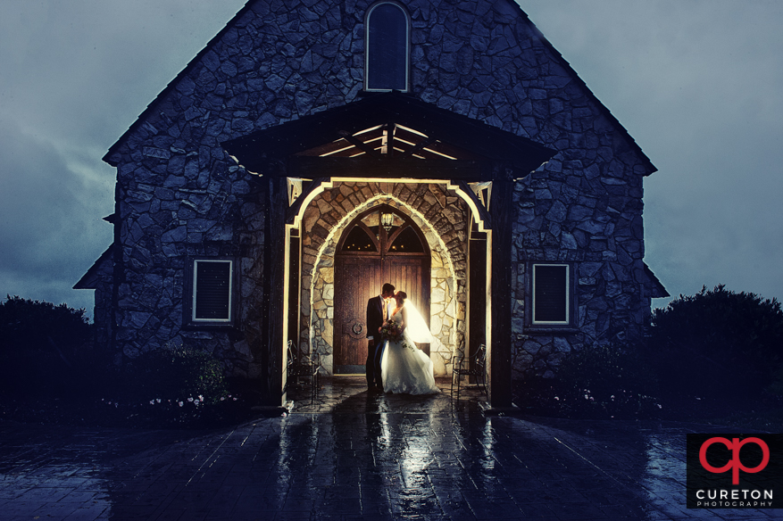 Couple in the rain after their Glassy Chapel wedding.