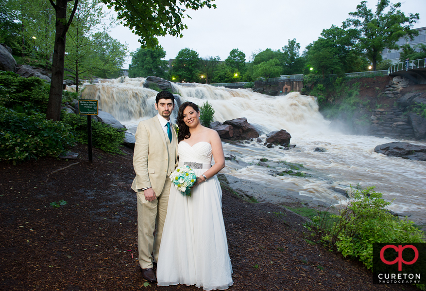 The reedy river rages during a rain wedding.