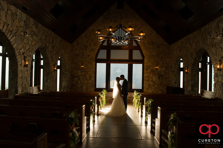 Couple stays dry by taking after wedding photos inside during a Glassy Chapel rain wedding.