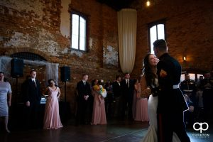 Bride and groom sharing a first dance at the wedding reception.