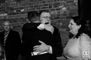 Bride's father getting emotional during a welcome speech at the reception.