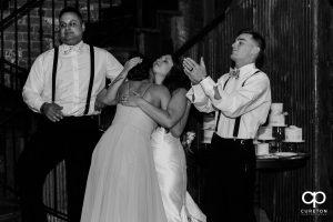 Bride hugging her bridesmaid after a speech.