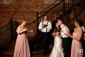 Bridesmaids giving speeches.