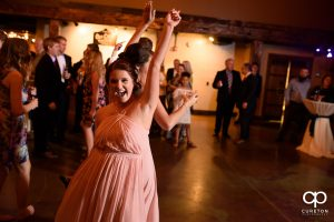 Wedding guests smiling and dancing at The Old Cigar Warehouse.