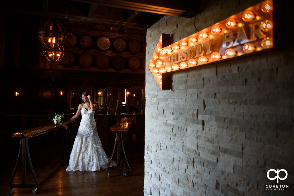 Bride holding her bouquet in the whiskey bar during a bridal session at Revel Event Center in Greenville,SC.