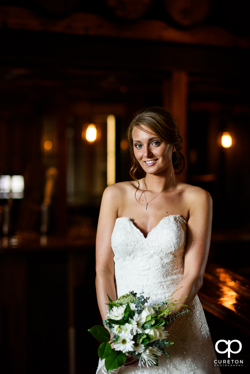 Bride holding her bouquet in beautiful light.