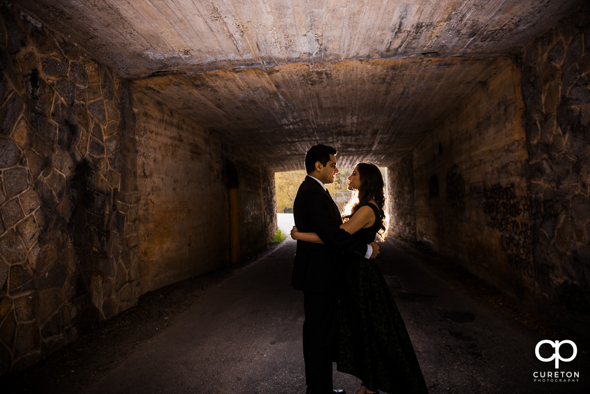 Future husband and wife dancing in a tunnel during their Cleveland Park engagement session in Greenville,SC.