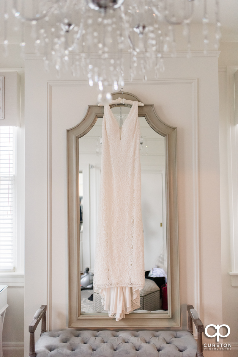 Bridal dress hanging in the bridal suite at Rocky River Plantation in Anderson.