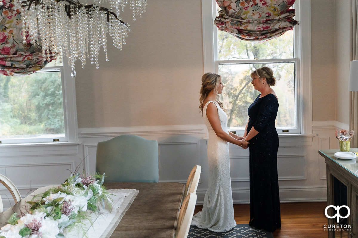 Bride and her mother having a moment in the bridal suite at Rocky River Plantation in Anderson,SC.