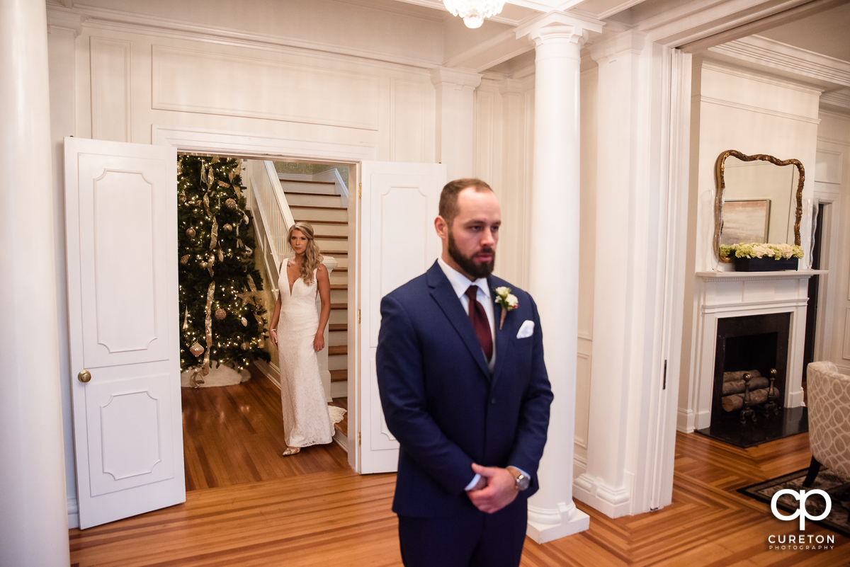 Groom waiting to see his bride for the first time on their big day.