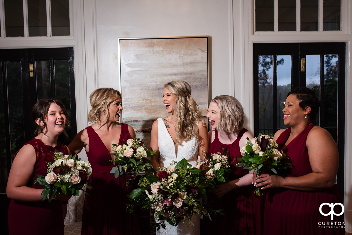 Bride laughing with the bridesmaids.