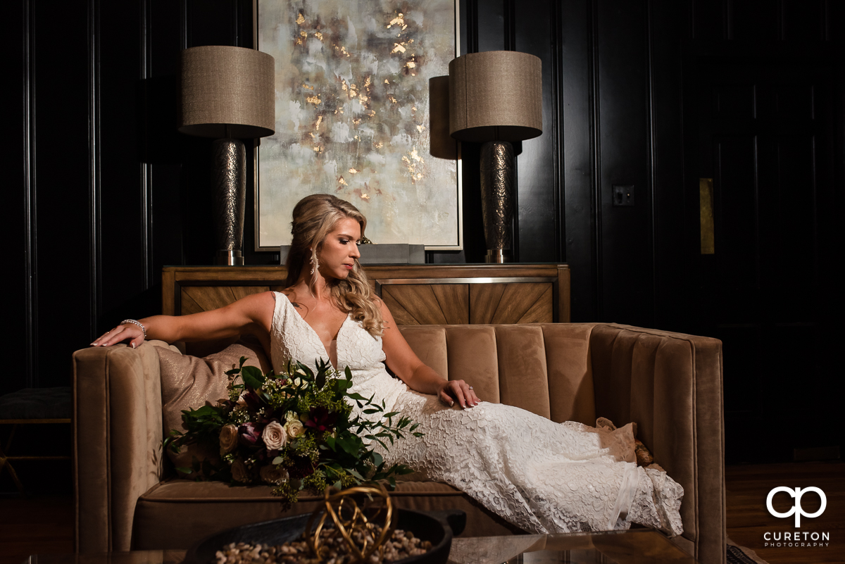Bride laying on a couch at Rocky Rover Plantation in Anderson,SC.
