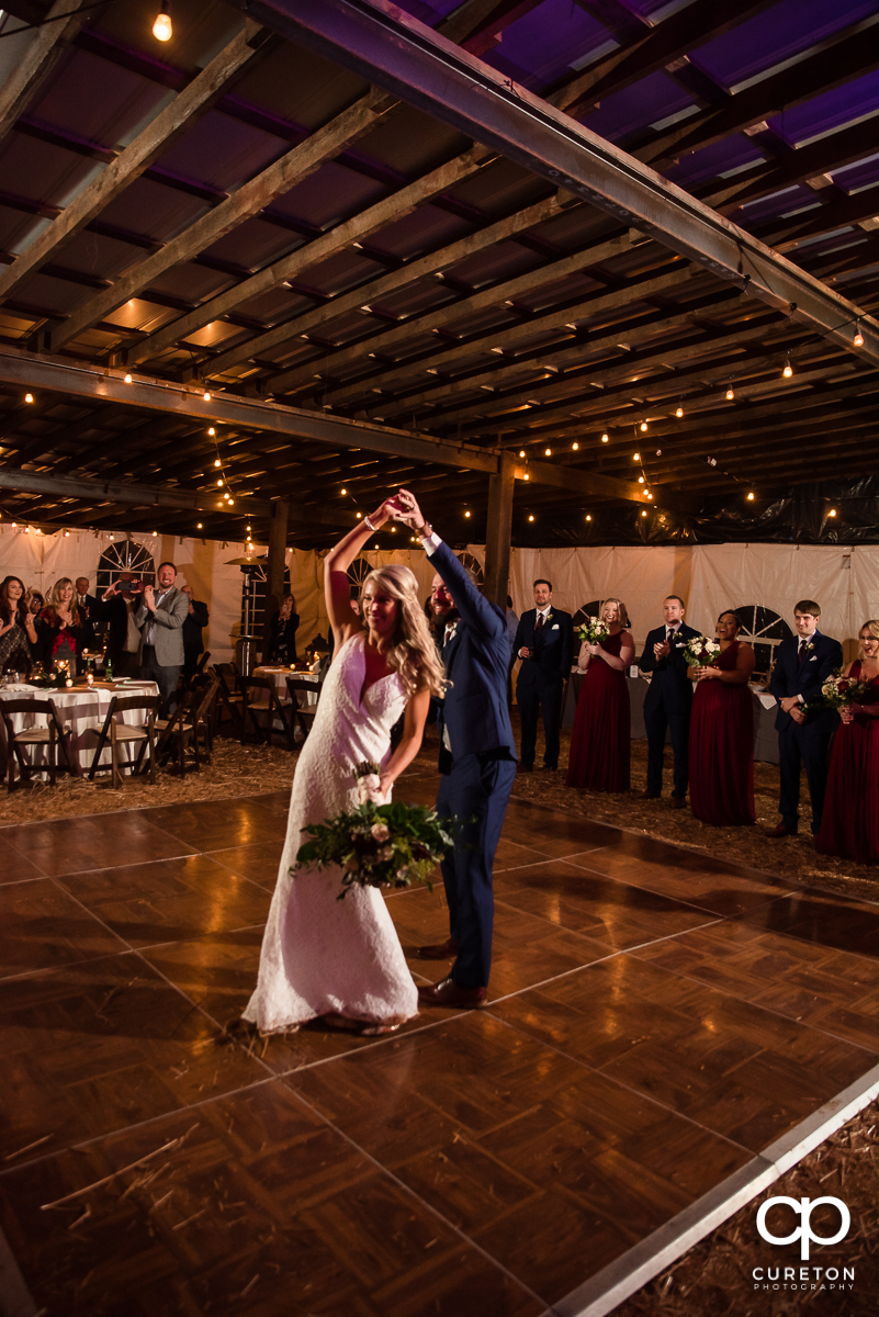 Bride and groom having a first dance at the Rocky River plantation wedding reception.