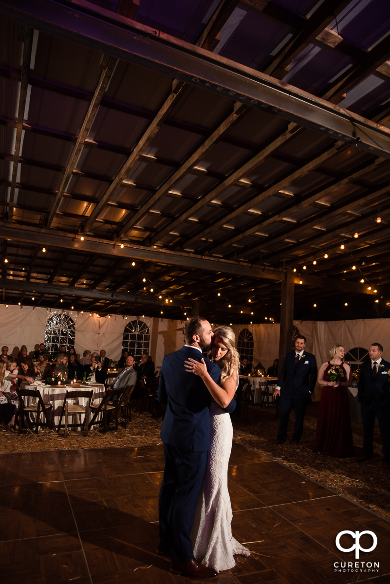 First dance in the barn at the Rocky River plantation wedding reception.
