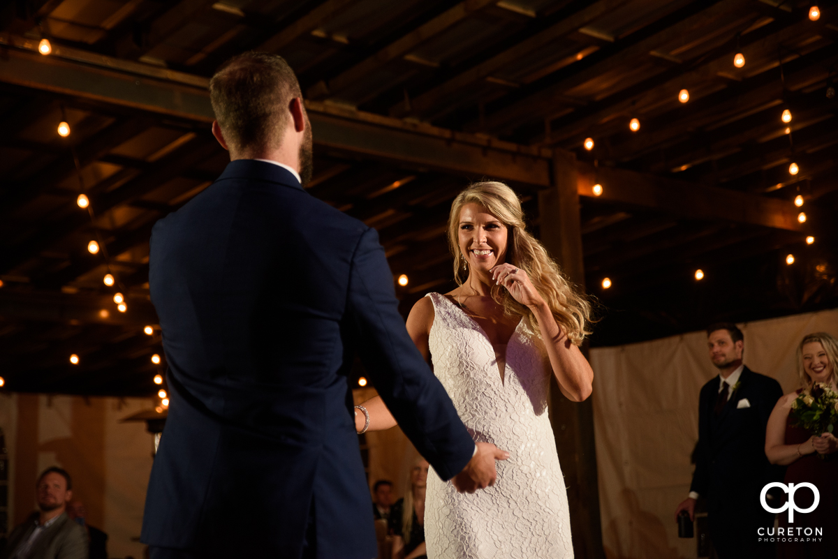 Bride and groom dancing at the Rocky River plantation wedding reception.