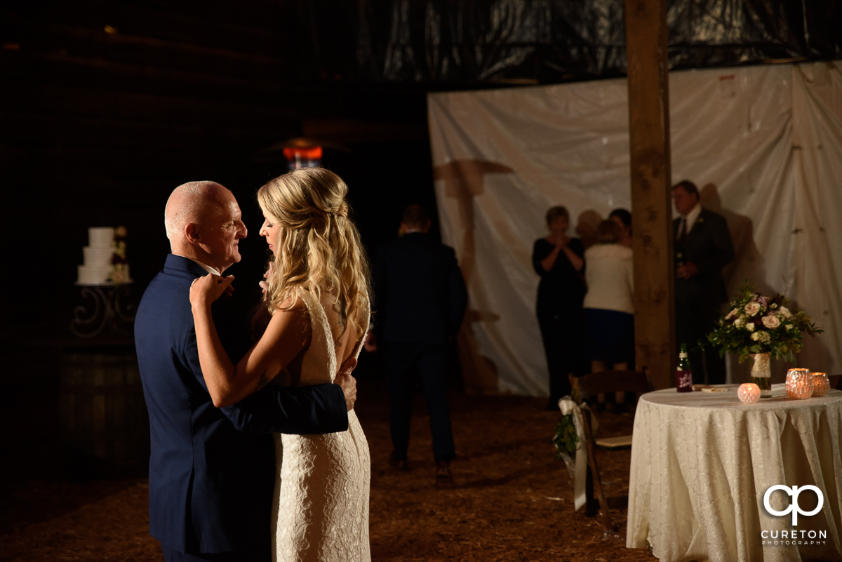Bride dancing with her dad at the reception.