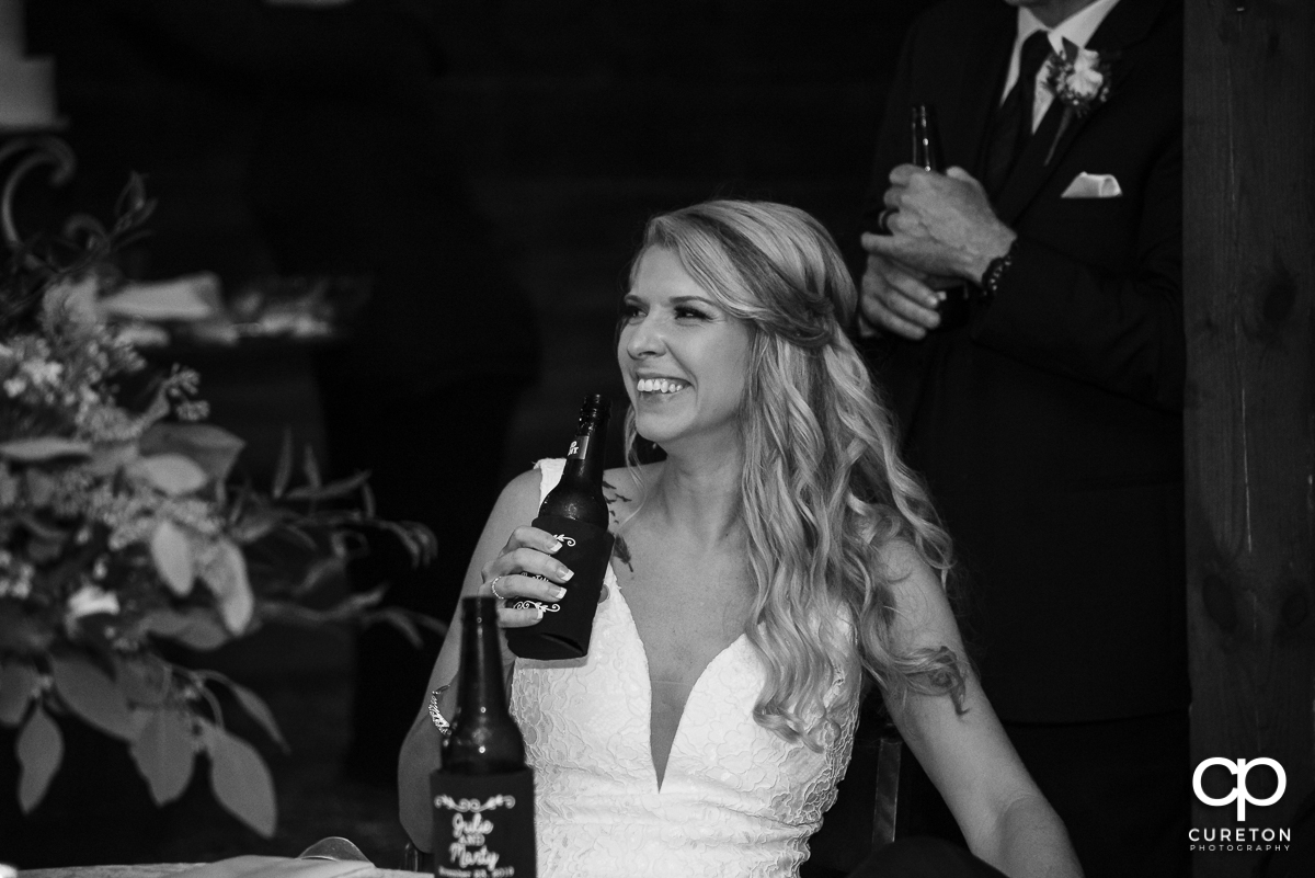 Bride laughing at the speeches.
