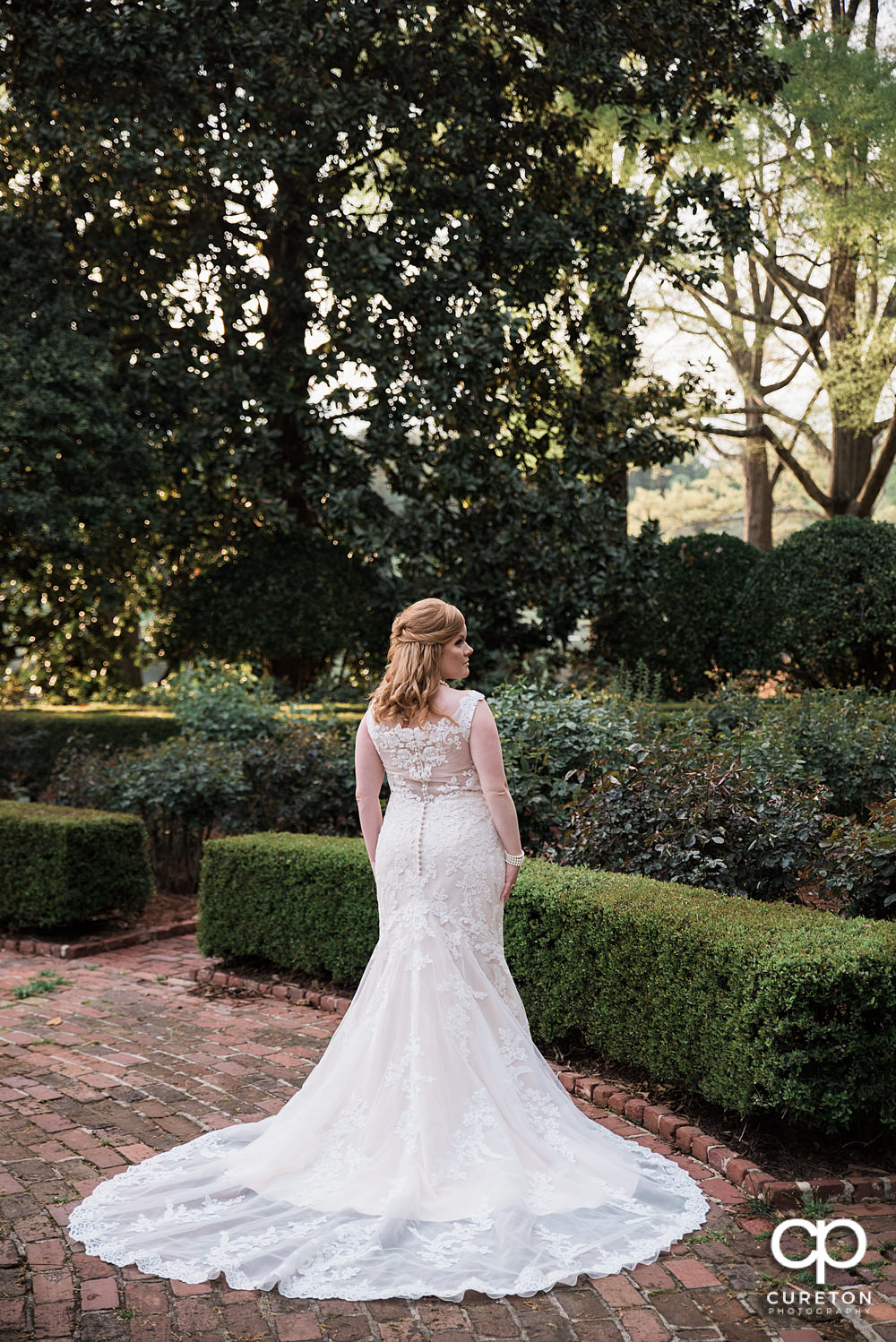 Epic back of the dress shot in the rose garden at Furman.