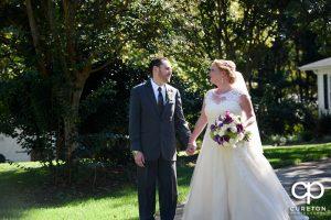 Bride and groom walking the grounds of the Ryan Nicholas Inn in Mauldin,South Carolina.