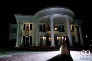 Bride and groom in front of the mansion during their Ryan Nicholas Inn wedding.