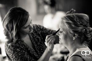 Bride getting her makeup applied.