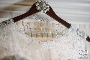 Bride's dress on a hanger.