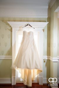 Bride's dress hanging.