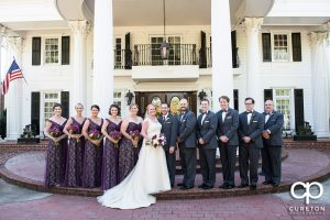 The wedding party in front of The Ryan Nicholas Inn.