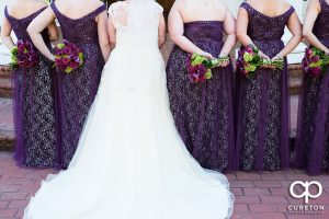 Back shot of the bride and bridesmaids.