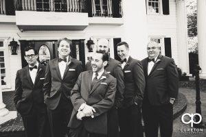 The groomsmen laughing.