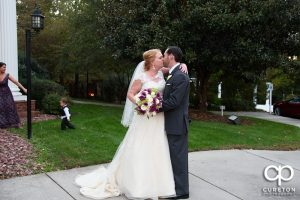Bride and groom kissing after the ceremony.