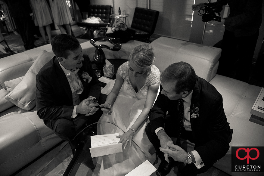 Bride and groom signing the marriage license.