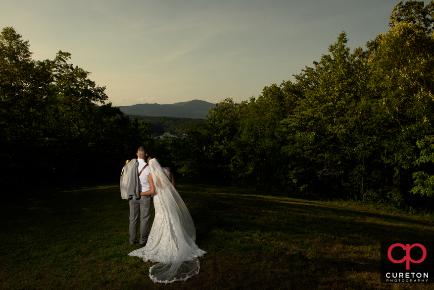 Couple staring off into the mountain view after their Song Hill Reserve wedding.