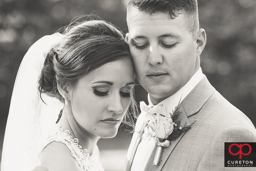 Gorgeous black and white photo of the bride and groom.