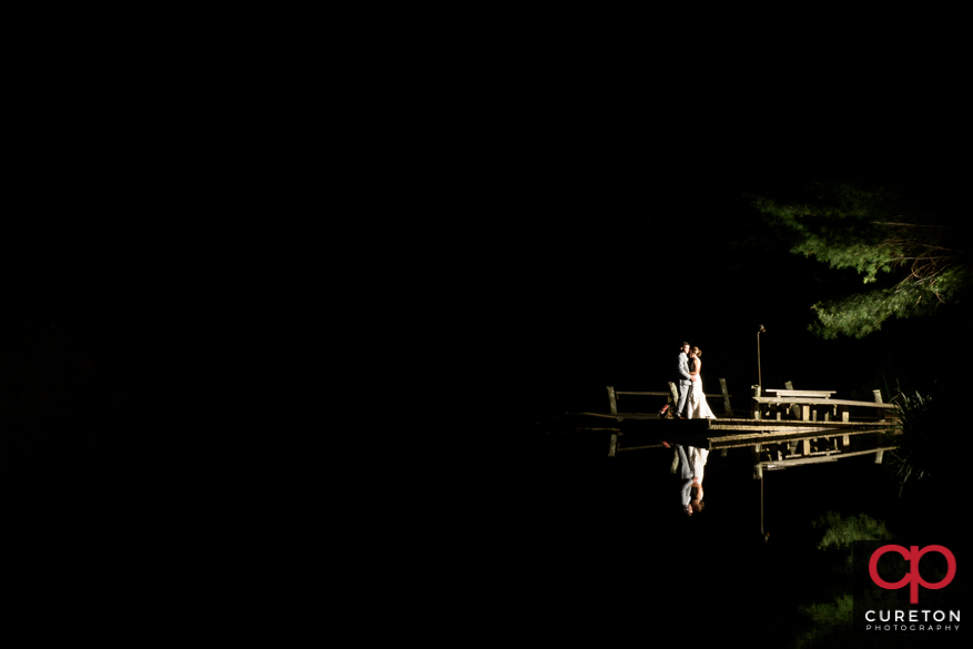 Couple by teh lake at Song Hill Reserve.