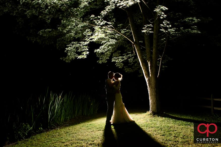 Epic backlit shot of the bride and groom.