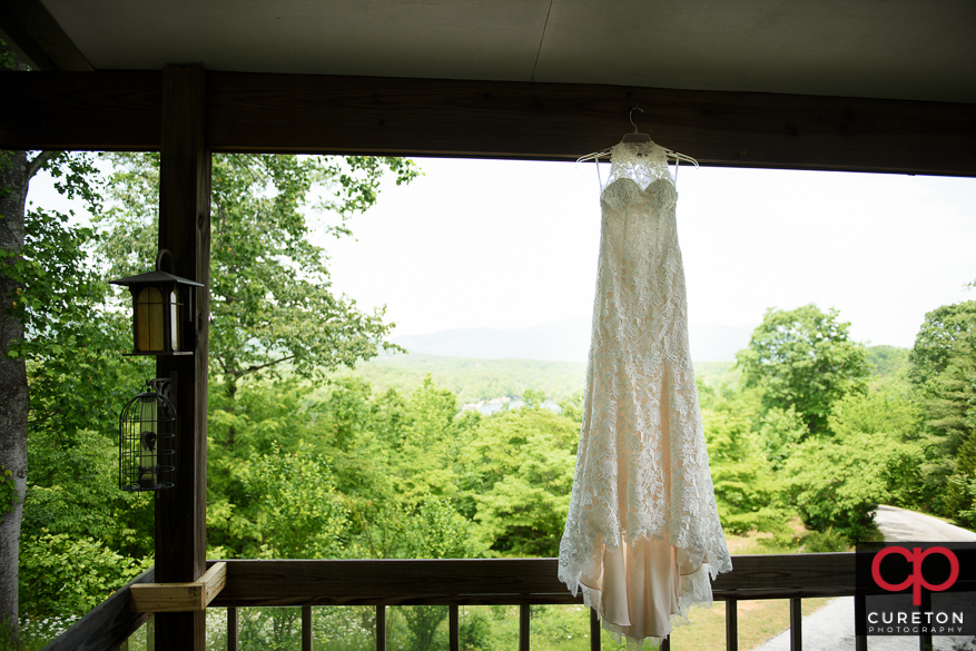 Wedding dress hanging outside.