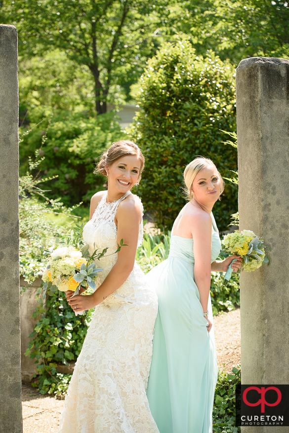 Bride having fun posing with her brdesmaids.
