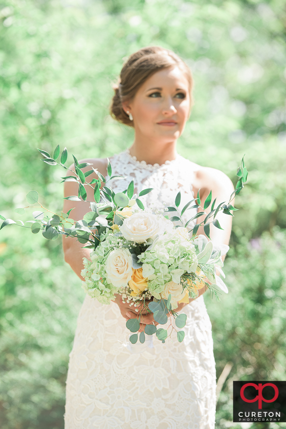 Bride and her amazing flowers.