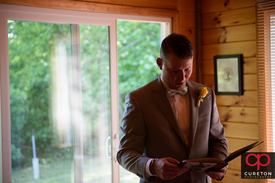 The groom receives his gift from his bride to be.