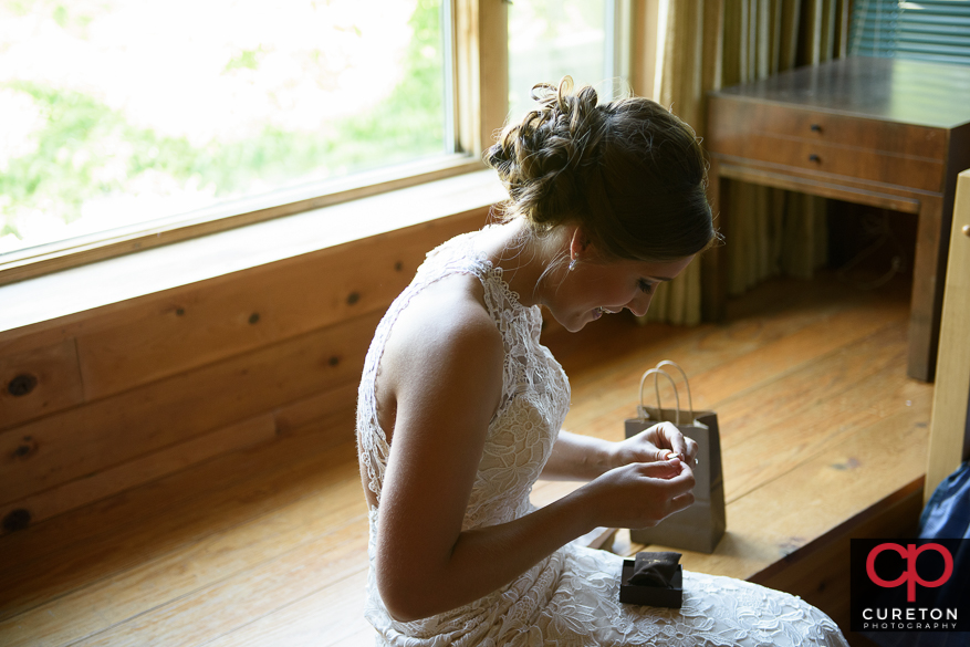 The bride receives her gift from the groom.
