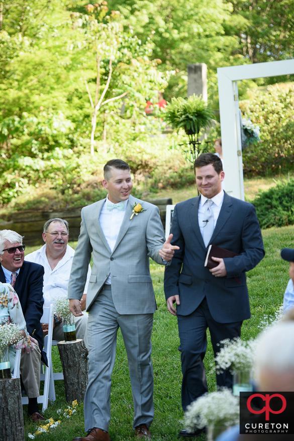 Teh groom walks down the aisle.