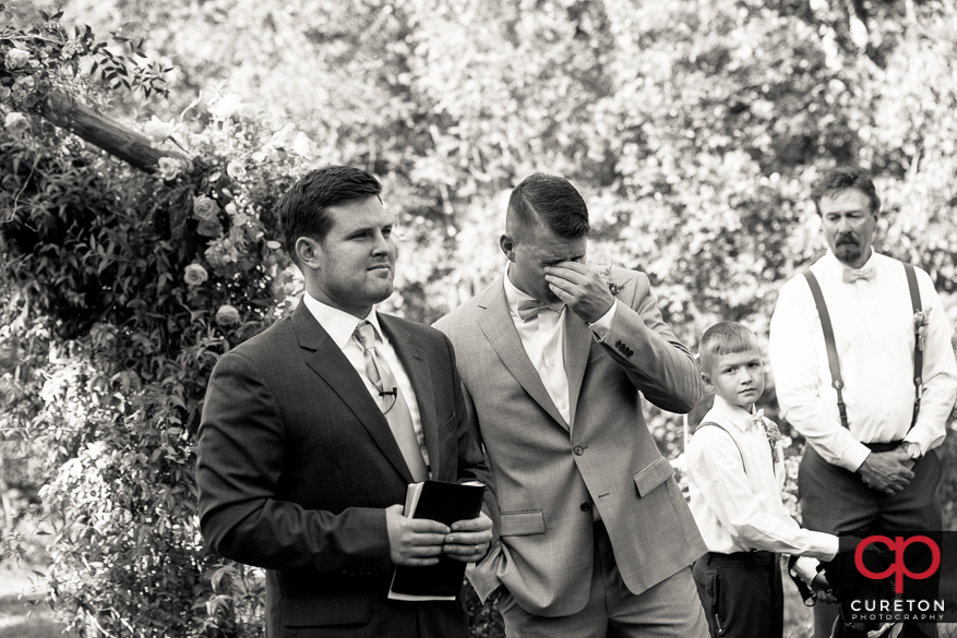 Groom tears up when he sees his bride for the first time.