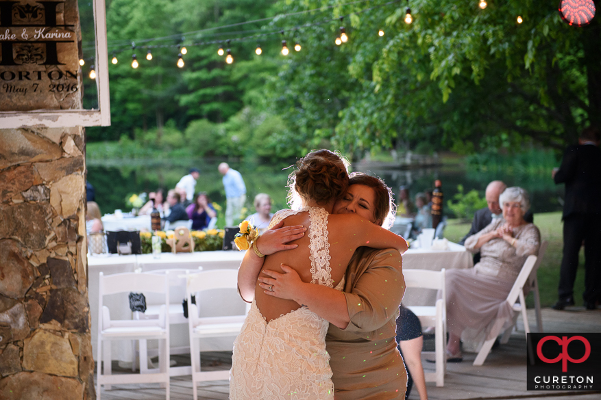 Bride and her mom dancing.