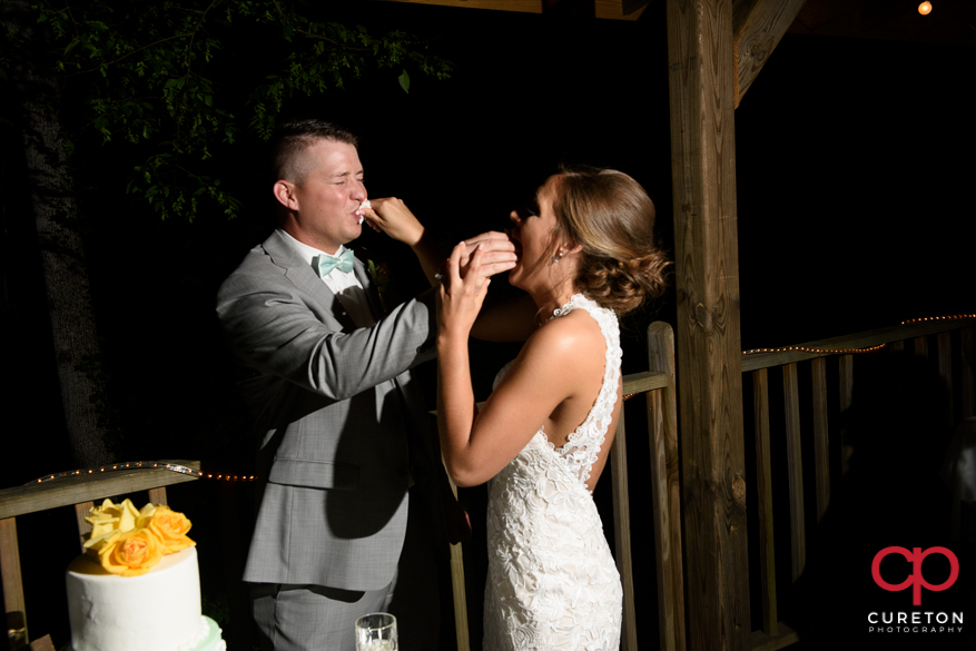 Bride and groom cut the cake.